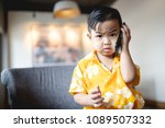 asian baby boy playing phone | Shutterstock . vector #1089507332