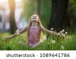 cute happy girl plays in the... | Shutterstock . vector #1089641786