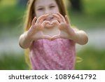 pretty little girl shows heart... | Shutterstock . vector #1089641792