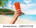 female hand holding sunscreen... | Shutterstock . vector #1089672728