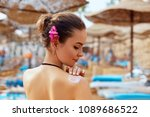 a female  applying sun cream... | Shutterstock . vector #1089686522