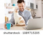 Young Man With Cute Cat And...