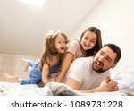 happy family at home in her... | Shutterstock . vector #1089731228