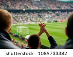 fans at the football match | Shutterstock . vector #1089733382