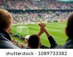 fans at the football match | Shutterstock . vector #1089733382