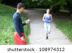 personal trainer timing a... | Shutterstock . vector #108974312