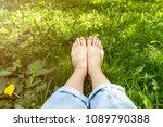 Girls Bare Legs Lying In Green...