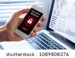 Small photo of Security breach warning on smartphone screen, device infected by internet virus or malware after cyberattack by hacker, fraud alert with red padlock icon
