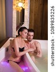 Small photo of squirrel fever. sincere affection. handsome brutal guy is hugging his girl in the bath