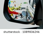 reflection from sideview mirror ... | Shutterstock . vector #1089836246