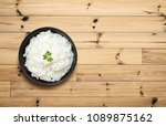 cooked rice in bowl on wooden... | Shutterstock . vector #1089875162