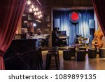 Stock photo modern jazz bar interior design stage with black piano and cello lamps above bar counter 1089899135