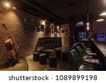Stock photo modern jazz bar interior design stage with cello lamps above bar counter 1089899198