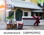 coins in jar with alarm clock...   Shutterstock . vector #1089903902