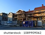 Small photo of Rebuilding old buildings with scaffold outdoor in sunny season - Kongsvinger, Norway (14th May 2018)