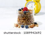 homemade muesli in a glass jar... | Shutterstock . vector #1089942692