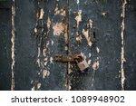 wooden dark grey door...   Shutterstock . vector #1089948902