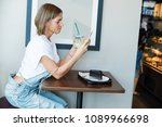 young woman wearing overalls...   Shutterstock . vector #1089966698