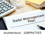 debt management plan on a table. | Shutterstock . vector #1089967355