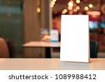 acrylic tent card on empty... | Shutterstock . vector #1089988412