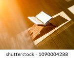 quran is holy book in islam... | Shutterstock . vector #1090004288