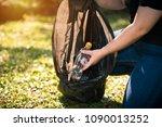 young volunteer picking up... | Shutterstock . vector #1090013252