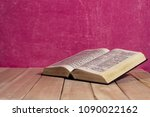 bible on a new wooden table.... | Shutterstock . vector #1090022162