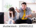 family pair watching football...   Shutterstock . vector #1090031312