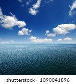 blue sea water surface on sky | Shutterstock . vector #1090041896