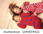 girl sisters in pajamas happy... | Shutterstock . vector #1090059422