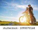 cyclist couple with mountain... | Shutterstock . vector #1090070168