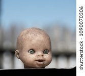 the terrible head from a doll.... | Shutterstock . vector #1090070306
