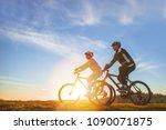 happy mountainbike couple...   Shutterstock . vector #1090071875