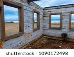 the ruins of a wooden house on... | Shutterstock . vector #1090172498