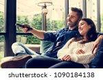 cheerful couple watching tv... | Shutterstock . vector #1090184138