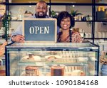 cake cafe owners with open sign | Shutterstock . vector #1090184168