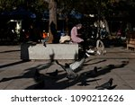 a migrant woman sits on... | Shutterstock . vector #1090212626