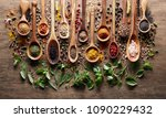 herbs and spices on wooden... | Shutterstock . vector #1090229432