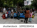 a family of refugees rest in...   Shutterstock . vector #1090230416