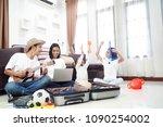 happy asian family on a floor... | Shutterstock . vector #1090254002