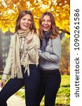 two happy young fashion girls... | Shutterstock . vector #1090261586