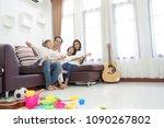 happy asian family in living... | Shutterstock . vector #1090267802