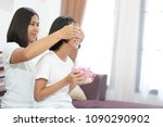 mother closed eyes give a gift... | Shutterstock . vector #1090290902