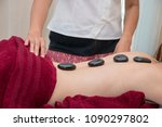 hot stone treatment for woman... | Shutterstock . vector #1090297802