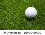 one golf ball is on green grass | Shutterstock . vector #1090298402
