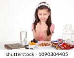 young muslim girl praying to... | Shutterstock . vector #1090304405