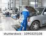 a mechanic working in a car... | Shutterstock . vector #1090325108