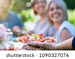 close up on a hand serving a... | Shutterstock . vector #1090327076