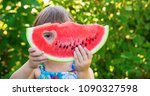 A Child Eats Watermelon....