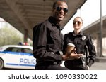 happy young police officers... | Shutterstock . vector #1090330022